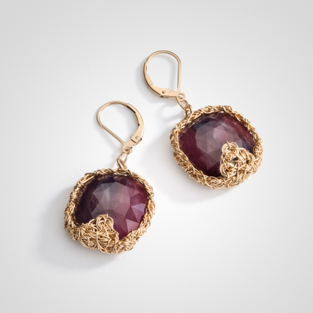 Red sapphire one of a kind earrings will make you stand out in a crowd.Gold brings out the color of this gem and compliments every skin tone.